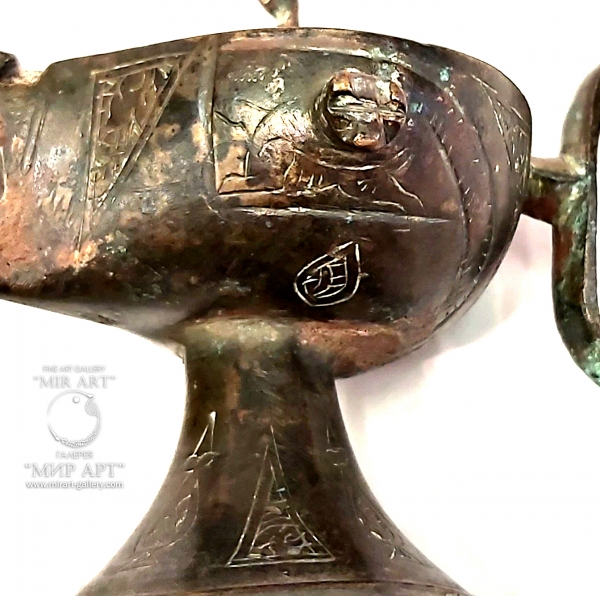 """""""Antique Islamic bronze oil lamp of the Seljuk period with an elephant handle, rich in Islamic patterns and inscriptions from the Holy Quran"""""""